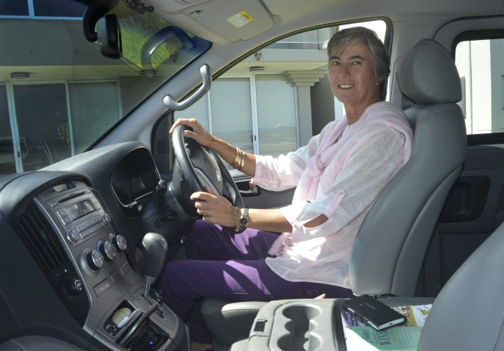 Julie driving her new tour bus